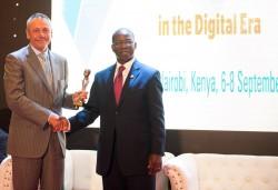 Gabriel Solomon receives award on behalf of UKTA