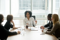 bigstock-Black-Female-Boss-Leading-Corp-229496896.jpg