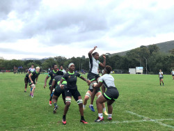 South African Women's Rugby Team On The Field In Action.jpg