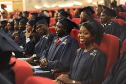 A PAUWES Class of 2017 graduate smiles at her graduation ceremony on 29 October 2017 at the Universi