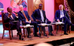 7 - Mr James Macharia, Dr Karl Ludwig Kley, Dr Evans Kidero and Dr Stefan Oschmann during a panel in