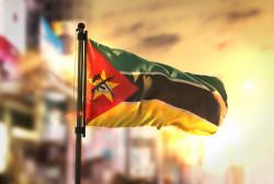 mozambique-flag-against-city-blurred-background-sunrise-backlight_1379-1596.jpg