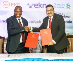 Standard Chartered CEO Sanjay Rughani with Minister of Finance and Planning Hon. Phillip Mpango.JPG