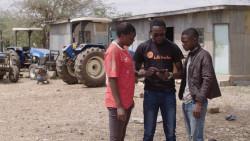 Farmer Using Hello Tractor App 1.jpg
