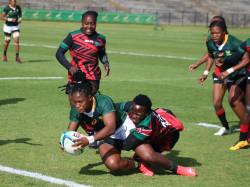 Zintle Mpupha Scoring A Try Against Kenya Women's Rugby Team.jpg
