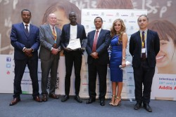 UNESCO-MARS 2016 'Best Young Researcher Award' 3rd place winner Lamin Cham from National Aids Control Program, Gambia with his award as Prof. Yifru Berhane, Minister of Health, Ethiopia; Prof. Dr Frank Stangenberg-Haverkamp, Chairman, Executive Board and Family Board of E.Merck KG; Prof. Afework Kassu Gizaw, Minister of Science and Technology, Ethiopia; Rasha Kelej, Chief Social Officer, Merck Healthcare and Ahmed Fahmi, Program Director, UNESCO